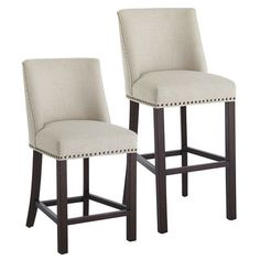 Deluxe style and comfort with a larger seat and scoop back for added support. Herringbone weave linen is stretched tightly over the back and padded seat and embellished with bronze nailhead trim. Solid wood legs with box stretchers provide welcome stability. A well-bred little barstool with superior genes.