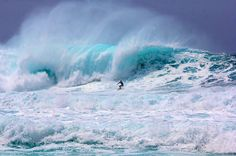 """Between the months of November and April, the waves at """"Pipe"""" (Banzai Pipeline) on the north shore of Oahu can be awesome and extremely dangerous. This surfer successfully navigated this wave during an April swell. Amazing to watch surfers ride these monsters."""