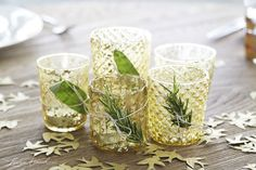 Here's a cute way to decorate votive glasses with leftover herbs! Source: LaurenConrad.com