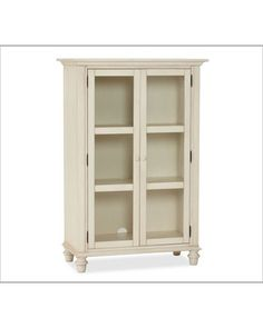 Set on turned feet and topped with crown molding, this glass-doored cabinet is a handsome home for everything from platters and stemware to books and collectibles. It has the look of a well-loved antique, and its slender silhouette lets it fit easily in smaller spaces. 38'' wide x 18.5'' deep x 56.5'' high Crafted with pine and rubber wood. Hand-applied Tuscan Chestnut and Almond White finishes. Pottery Barn 999.00