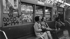People in a graffiti-covered carriage in New York in 1972