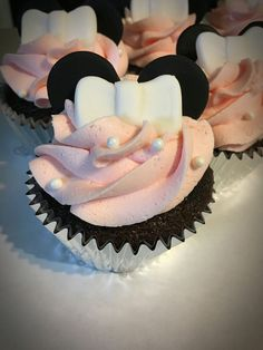 Adorable pink Minnie Mouse cupcakes. Buttercream frosting and I made bows and ears from fondant.