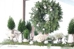 Courtney's discussion on Hometalk. Silver, greens and whites~ Quiet Christmas Mantel - Polished silver,fresh greens and white roses help create a quiet Christmas  mantel