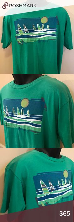 """80s Hawaii Sailing Shirt Sunset Waikiki Beach Duke 80s Vintage Hawaii Sailing Sunset Tee Shirt Great retro Hawaii shirt with sail boats under a classic sunset. Great fit, great feel. Soft and thin to the touch. Epic colors, great graphics, and of course Hawaii is paradise. Enjoy a Mai Tai wearing this shirt...  ♥♥♥ Color: Green MADE IN USA Material: 50/50 Cotton Poly Blend Condition: Excellent Vintage  ✂-----Measurements Tag: Hanes Fifty-Fifty Fits like: Large Chest: 21"""" Sleeves: 15"""" Length…"""