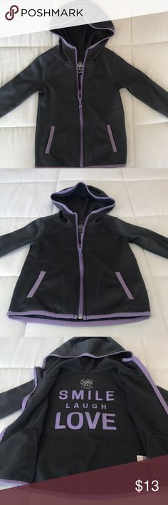 Girls Justice Zip Up sweatshirt. Hoodie 6. Girls Justice Zip Up sweatshirt. In a size 6. Grey/purple.  In good condition. Thumb holes in the sleeves.  100% Polyester.  Bundle and save. Justice Shirts & Tops Sweatshirts & Hoodies