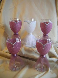 Lovely Handmade Glitter Bride and Bridesmaid Wine Glasses (above colour is Dusty Pink). Choice of 29 colour available, if you cannot see the colour you require, please message me and I will do my best to accommodate. An average of an inch is left clear from the rim to allow for #GlitterProjects