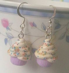 Cupcakes are a girl's best friend! Show off your sweet side with these cute sprinkled cupcake earrings. They are hand molded out of polymer clay and glossed for extra durability and shine.  By Cuddlebugeeshi on Etsy.  $3.50    I MUST have these!