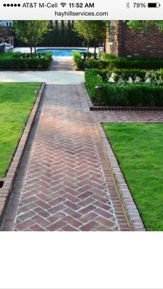 FENCE This herringbone brick path with raised brick border creates a perfect axis to the swimming pool. The courtyard is enclosed by brick columns with custom wrought iron fencing and accented with an elegant boxwood hedge and zoysia sod. Brick Columns, Brick Pathway, Front Walkway, Wood Walkway, Front Steps, Landscape Plans, Landscape Design, Back Gardens, Outdoor Gardens