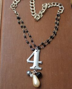 Found Object Number 4 charm necklace by outoftheblue on Etsy, $45.00
