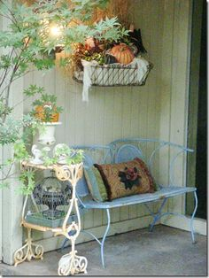 Denise's porch with her chippy light blue settee, from her Bella Dreams blog.