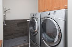 Laundry: stained cabinets, ceramic tile pet shower surround