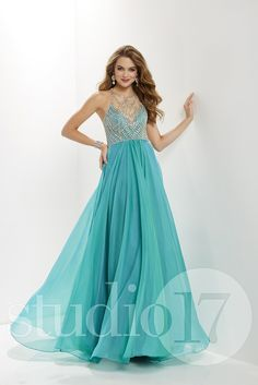 8d85334c1679a Studio 17 12655 is a sleeveless Prom Dress with an illusion halter neckline  beaded in a rhinestone design. The A-line skirt is of two tone chiffon.