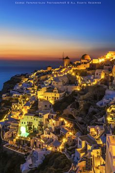 via 500px / Oia Santorini in blue hour by George Papapostolou Greece