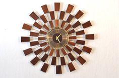 Mid Century Modern Seth Thomas Grandeur Sunburst Atomic-Style Wall Clock by DeedlesShop on Etsy https://www.etsy.com/listing/223985326/mid-century-modern-seth-thomas-grandeur