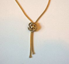 """1970s pendant necklace in snake chain gold tone metal with a metal flower as its drop. It is approximately 84 cm, 32"""" in length and in good vintage"""