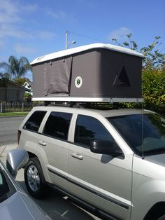 Beautiful Jeep Grand Cherokee featuring a Bigfoot Roof Top Tent www. Jeep Tent, Jeep Camping, Jeep Truck, Roof Rack Tent, Roof Top Tent, Top Tents, Jeep Grand Cherokee, Sport Suv, Popular Sports