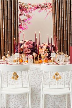 A festive and colourful traditional Chinese banquet with lighted red candles and blooms // While 2017's Pantone Colour Of The Year symbolised new beginnings, Ultra Violet looks toward the future. With this in mind, the team behind Formosa Events sought to create a contemporary oriental-inspired table setting for the modern couple. Hand painted details and lush floral arrangements add a feminine touch to this styled shoot, captured by Pepper and Light.
