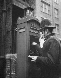 A Bobby using a Police call box (Non-Tardis version), circa late Police Call, Police Box, Police Officer, Vintage London, Old London, Victorian London, London Pubs, London History, British History
