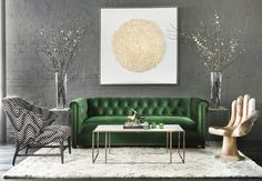 Emerald Settee - This emerald and gold stunner captivates and energizes the senses. A lush velvet sofa brings glamour to the space, glittering gold artwork provides a focal point, and a curved teak chair adds a    unique touch.