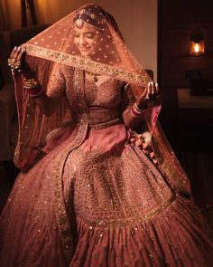 This coral pink lehenga is a sure shot win for a glam wedding day look ! Indian Bridal Outfits, Indian Bridal Lehenga, Indian Bridal Fashion, Indian Bridal Wear, Pakistani Bridal Dresses, Indian Dresses, Latest Bridal Lehenga, Bridal Dupatta, Bollywood Bridal