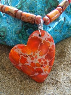 Orange Varascite Heart on a string of Beads that match.... MEASURES ~43cm or 17inches in length... This is the most amazing colour... so bright and cheerful, the colour of plenty yes the colour of Abundance as well. ♥... This is the colour that would make you feel or fuzzy inside.... $55 Aust +ph