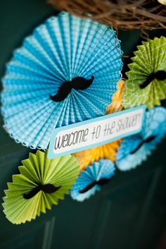 Mustache Baby Shower Wall Decorations. Very cute idea to use fans, or honeycomb balls and attach mini mustaches or bow ties.
