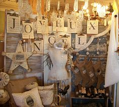 holiday display. rolls of fabric remnits. clip boards. white tree branch. (would look cute with fabric rip banner) Maybe doilies hanging from childs wire spring frame with white lights.