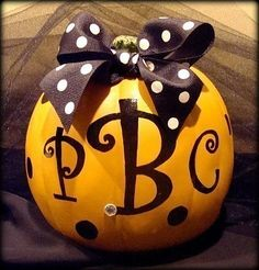 """Cute pumpkin - sometimes carving is just a messy pain.  Can be child's name or person's initials, or """"Harvest"""" or whatever.  Love polka-dot grosgrain ribbon, can also be sheer or wired.  Can't tell if the dots are painted on, or buttons.  Painting a papier-mache pumpkin would last longer than painting a real one."""
