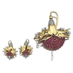 Gold, ruby and diamond demi-parure, Horovitz, circa 1940. Comprising: a clip and a pair of ear clips of stylised floral and fruit design, set with circular-, single-cut and baguette diamonds, highlighted with carved leaf cabochon rubies. Wolf Horovitz was one of the leading Egyptian jewellers, based on rue Chérif Pacha in Alexandria, who catered to the local élite clientele and the Royal Courts of King Fouad I and King Farouk I.