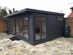 This building has been painted in 2 coats Sadolin Superdec 'Anthracite' Backyard Cabin, Garden Cabins, Backyard Studio, Outdoor Buildings, Backyard Buildings, Timber Buildings, Outdoor Garden Rooms, Garden Spaces, Tiny Modular Homes