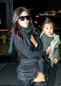 How freakin' adorable is Nori in her green jacket, black tights and little Timberland boots?!