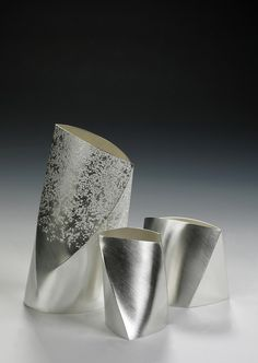 Textured pouring vessels by Esther Lord.