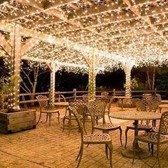 Put lights under the outside patio. Hang white icicle lights to create magical outdoor lighting. This idea works well for decks, patio lights and covered porches. Imagine these icicle lights at an outdoor wedding reception? Icicle Lights, Led Fairy Lights, Solar Lights, String Lights, Light String, Garden Fairy Lights, Twinkle Lights, Lights On Porch, Fairy Lights Ceiling