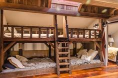 Slumber party at your house! The frame and rails of these fantastic bunk beds were made from antique barn beams. The top bed is a twin and the bottom beds are full size. Windows were installed in the lanthorn above, allowing natural light to stream down into the space.