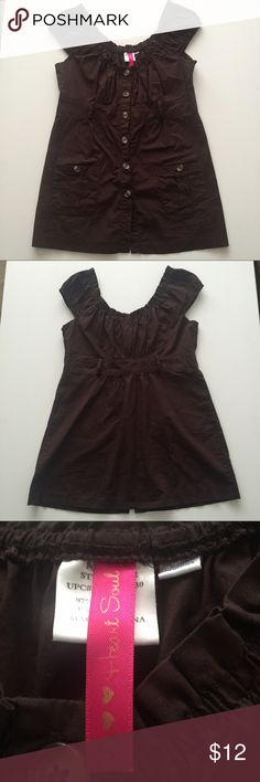 HeartSoul Brown Babydoll Shirt Size M Cute button down top with stretchy round neck and shoulders. Also a decorative button pocket on both hips. This could also be a mini dress or worn with leggings/jeans depending on the torso of the wearer.  Also has belt loops but no belt.   **** There is one button missing at the BOTTOM of the shirt, hardly noticeable and easily fixable**** Chest 17in Length 19 3/4 in Bottom across 21in Comes from a pet and smoke free home HeartSoul Tops Button Down…