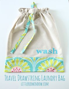 Travel Drawstring Laundry Bag Tutorial  |  littleredwindow.com | Make an pretty and useful travel laundry bag with cute stenciled detail with this great tutorial!  #craft #sewing #diy #travel