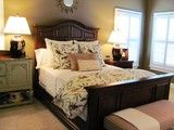 """""""Idea of using quilt to cover bed, then quilt at foot of bed with matching shams?""""  """"the antiqued furniture, the neutral colors, the bird themed bedspread""""  """"yellow beige with green accents"""""""