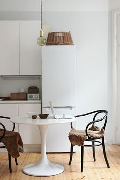 i do like the idea of small bentwood chairs because they feel and look rather light, via design*sponge.