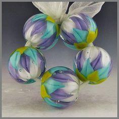 set of 5 encased lotus round beads handmade by PolychromeBeads, $60.00