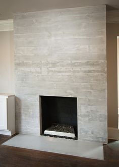 Board formed concrete with slight angled offset to each board concrete fireplace finish google search solutioingenieria Choice Image