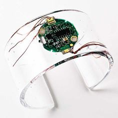Cirkuita Band - Bracelet - computer circuit. This would be a great crystal resin project for me. I've got a load of used computer circuit boards hanging around.