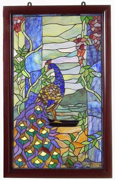 <li>Window panel has been handcrafted using methods first developed by Louis Comfort Tiffany<li>Tiffany-style panel features a detailed peacock motif with floral accents<li>Window treatment includes a sturdy wooden frame with a mahogany finish