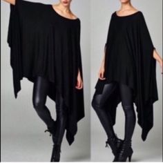The AINSLEY poncho tunic top - BLACK Loose fit, round neck, asymmetrical hemmed poncho-style tunic with slit armholes. Available in black & steel blue.   Fabric: 95% Rayon, 5% Polyester. Made In: U.S.A,   FITS FROM SMALL - XL   ‼️️NO TRADE, PRICE FIRM!! Bellanblue Tops