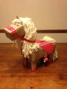 We made this for my daughter Addison's Valentine's Day box this year (2015). We found inspiration in a horse box on Pinterest but found no directions to it. So we are leaving directions as follows.  Shoe box-body, stick butter box-head, 4 toilet paper rolls-legs, 3/4 of Suran wrap roll (neck), Paper towel roll (ears) and use to wrap yarn 50xs to make 2 manes. Yarn 2 googly eyes, 2 buttons-nostrils, small star-forehead, Hot glue gun, Tan paint-lid, Valentine paper chains,Foam heart, rectangle…