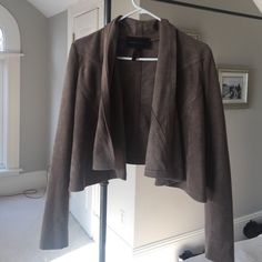 BCBG Max Azria faux suede jacket. XS This Is a great piece to add to your wardrobe! Pretty mink color that goes with everything.  Arms have stretch knit detail which makes it super comfy! Front lapels are draped and bit swingy. Perfect for year round use. Excellent condition! BCBGMaxAzria Jackets & Coats