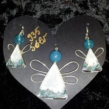 My army of angels: pendant and earrings made from .935 silver wire and band with Angelite stones encased in epoxy resin.