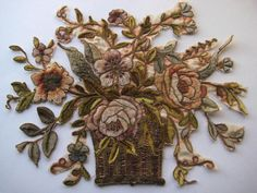 This outstanding antique French appliqué was salvaged from a stunning antique French pillow, which had unfortunately seen better days.  This appliqué