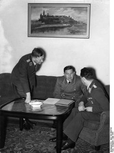 Josef Bühler (1904 – 1948, sitting in the middle) was a secretary and deputy governor to the Nazi-controlled General Government in Kraków, Poland. He was intimately involved in the Final Solution. Bühler attended the infamous Wannsee Conference on Jan 20, 1942 as the representative from the Governor-General's office; the conference streamlined the collaboration between Nazi departments for the liquidation of European Jewry. In 1948 he was hanged for his troubles at his former seat of Krakow.