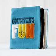 Kids Toys: Counting Fun Felt Book in Baby Toys. Two giraffes sewn in for the number two, and four elephants were sewn in for number four.  This fabric looks like fleese  or a very soft felt.