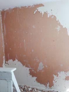 Removing woodchip wallpaper.  1. score 2. steam 3. strip